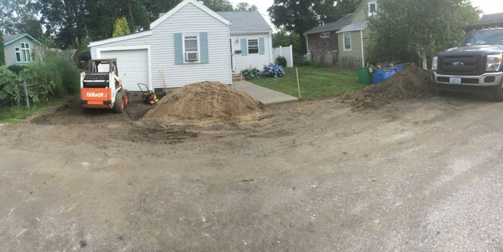 Excavating the base for the driveway and walkway